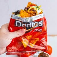 Hand holding up bag of Doritos Walking Tacos square image