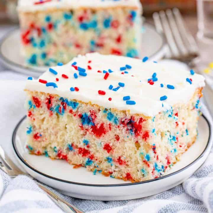 Square image of one slice of Funfetti Cake on white plate