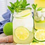 Square image of Mojito in glass garnished with mint and lime