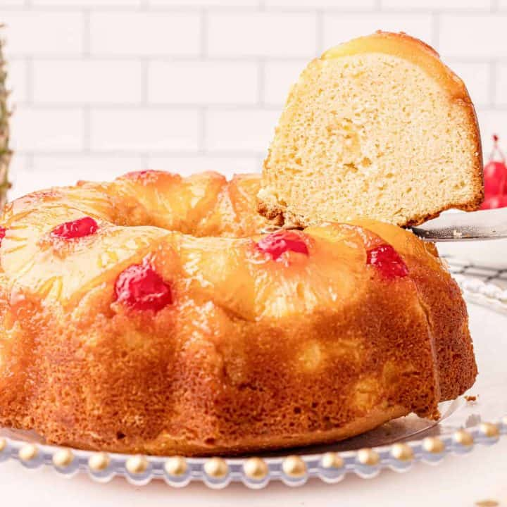 Close up of finished Pineapple Upside Down Bundt Cake Recipe with slice being removed
