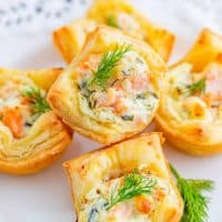 Square photo of Puff Pastry Bits stacked on white plate
