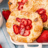 Square image of one Strawberry Cheese Danish topped with powdered sugar