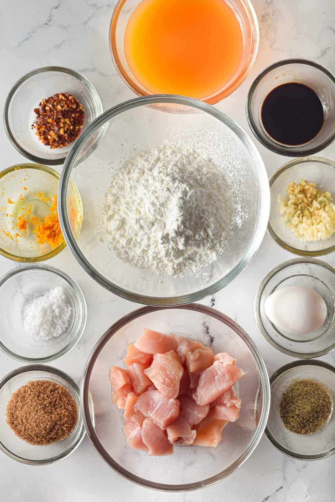 Ingredients needed: chicken breasts, egg, salt, black pepper, soy sauce, corn flour, orange juice, rice vinegar, soy sauce, ginger, garlic, orange zest, brown sugar, chili flakes and water.