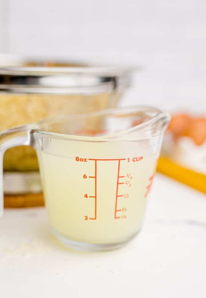 Reserved cooking water shown in a measuring cup.