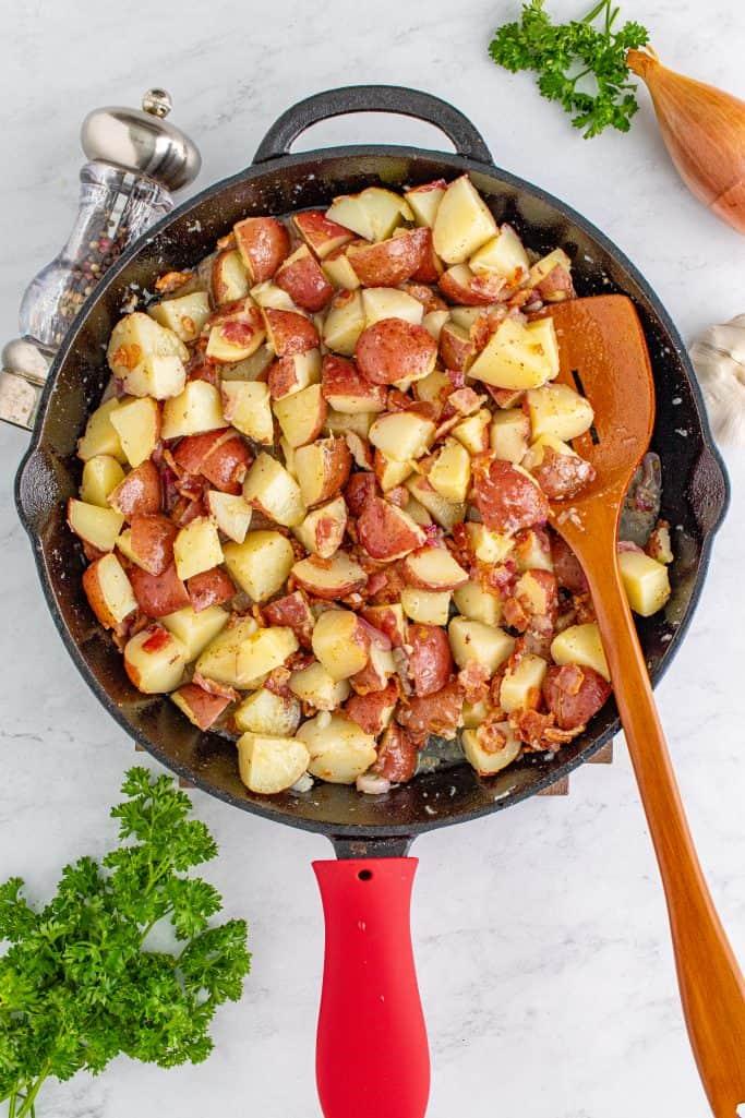 German Potato salad being stirred together.