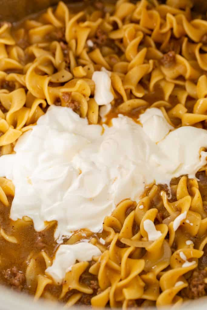 Sour cream added to finished cooked noodles and beef.
