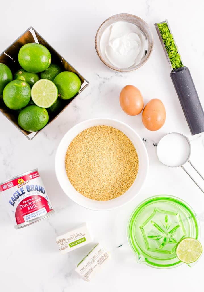 Ingredients needed: graham cracker crumbs, granulated sugar. salted butter, fresh key lime juice, key lime zest, sweetened condensed milk, sour cream and egg yolks.