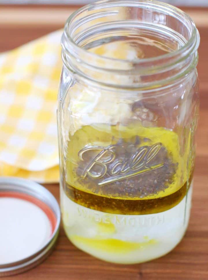 marinade ingredients shown in a large mason jar.
