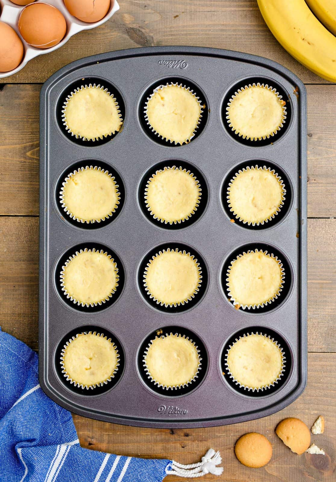 Fully Baked Mini Banana Pudding Cheesecakes in muffin tin.