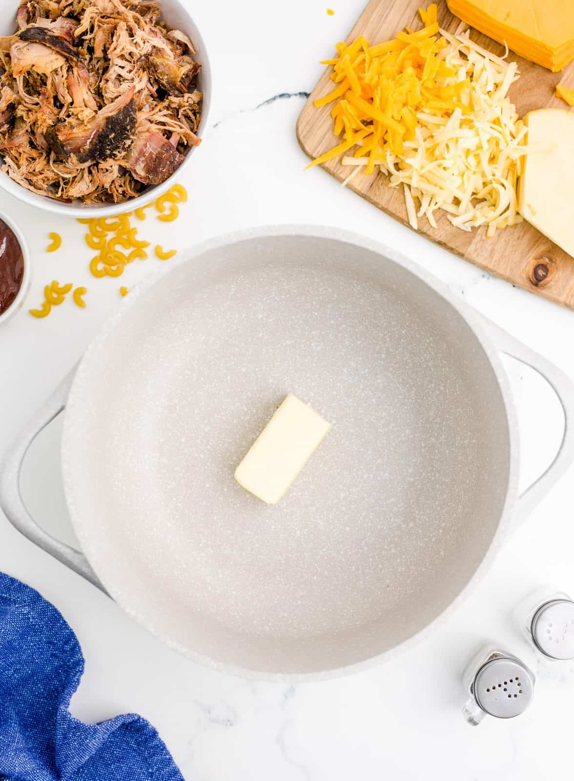 stick of butter in a dutch oven.