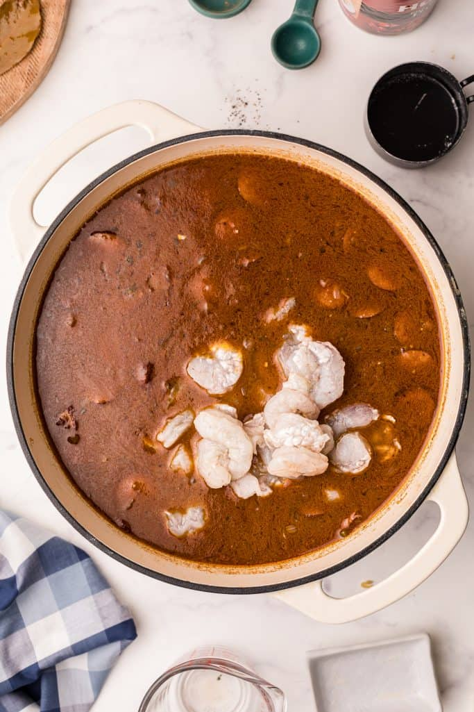 Sausage, okra and shrimp added to gumbo mixture