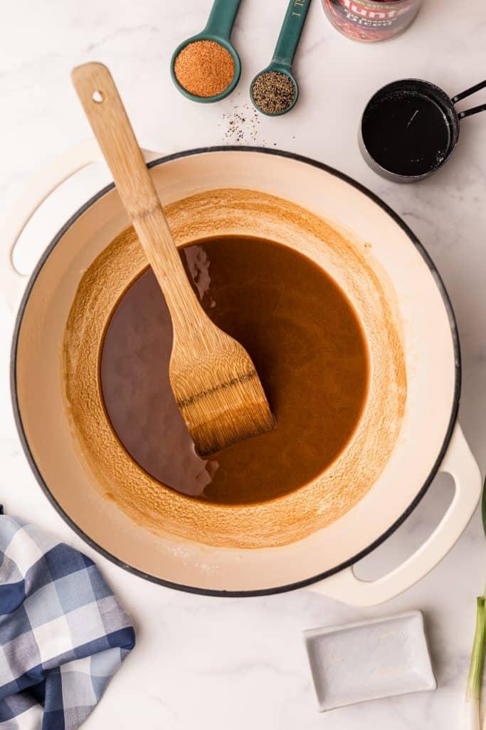 A dark roux in bottom of dutch oven