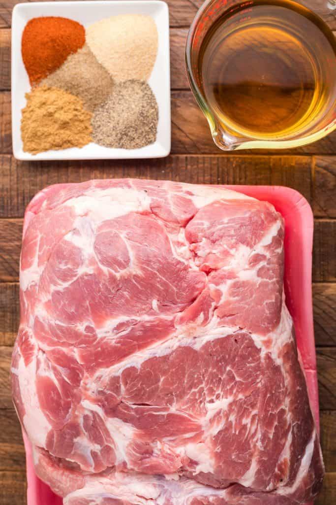 Ingredients needed: pork shoulder, cumin, black pepper, garlic powder, ancho chili powder, celery salt and apple juice.