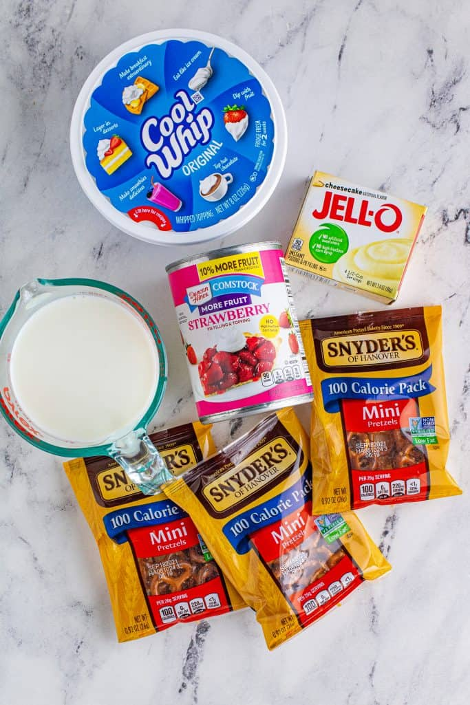 Ingredients needed: instant cheesecake pudding mix, milk, mini pretzel bags, strawberry pie filling and cool whip