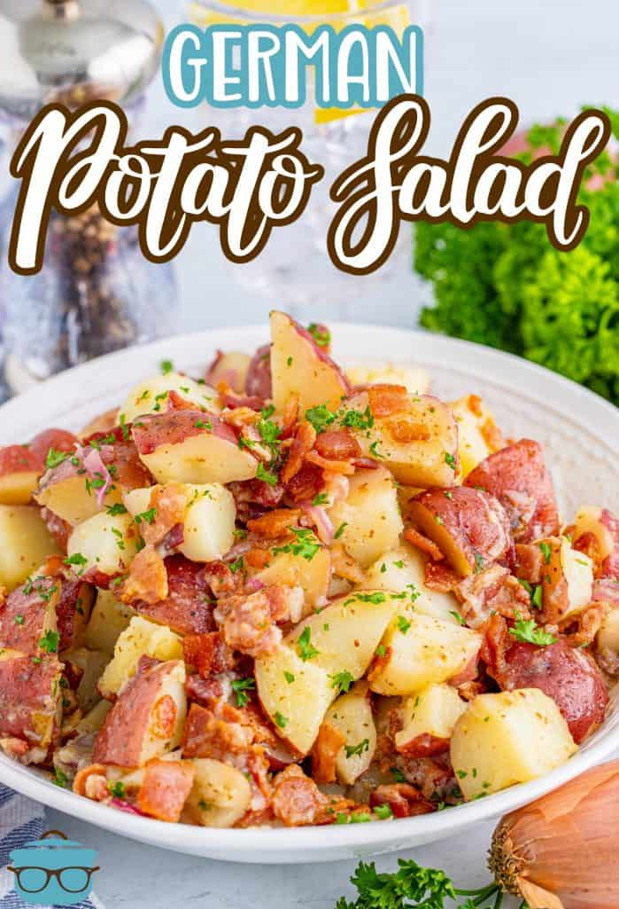Pinterest image of German Potato Salad recipe in white bowl with parsley in background