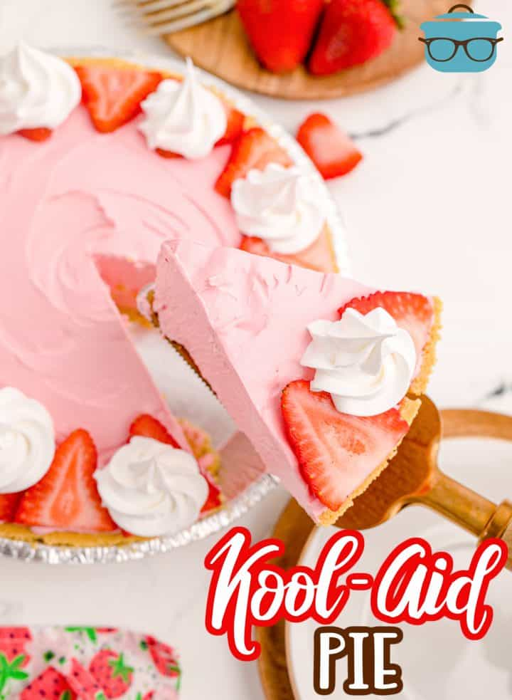Overhead photo of Strawberry Kool-Aid Pie being held up by pie server.