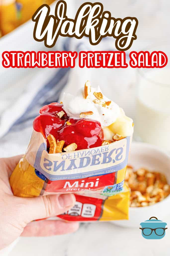 Hand holding up a bag of Walking Strawberry Pretzel Salad showing filling, whipped topping, and pretzels Pinterest image
