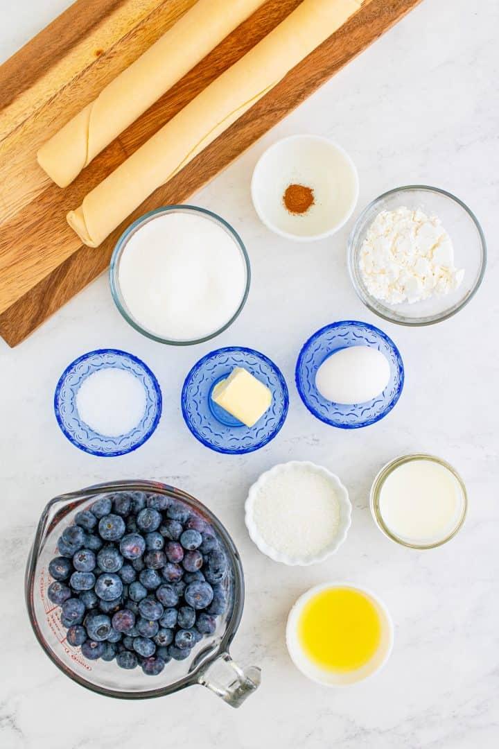 Ingredients needed: Refrigerator pie crusts, blueberries, granulated sugar, cornstarch, lemon juice, ground cinnamon, sea salt, unsalted butter, egg, whole milk and decorators sugar.