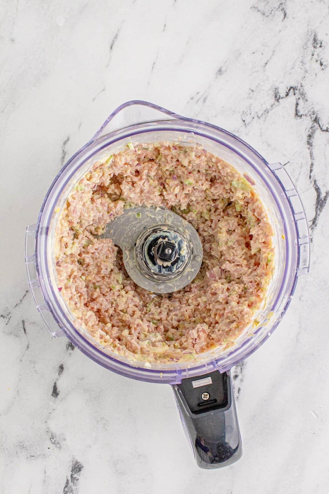 Blended up pinwheel ingredients in food processor. Overhead photo.
