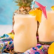 Square image up close of Pineapple smoothie in glass garnished