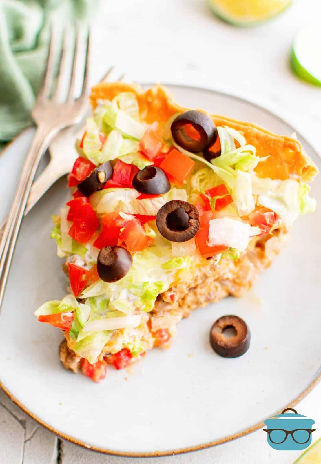 Slice of Homemade Taco Pie on white plate.