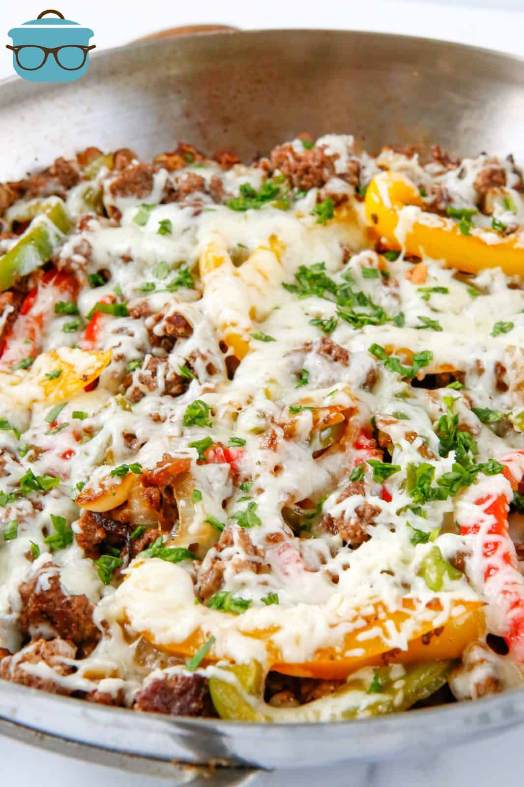 Philly Cheesesteak Skillet in skillet with melted cheese.