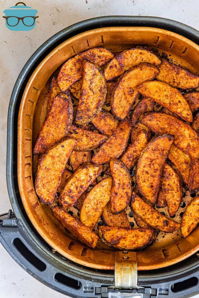 Finished Air Fryer Potato Wedges in air fryer basket.