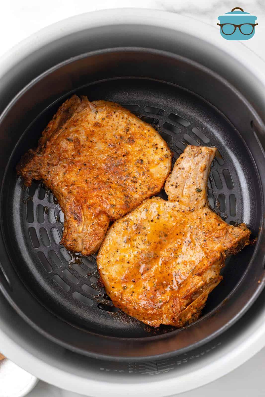 Cooked pork chops in air fryer.