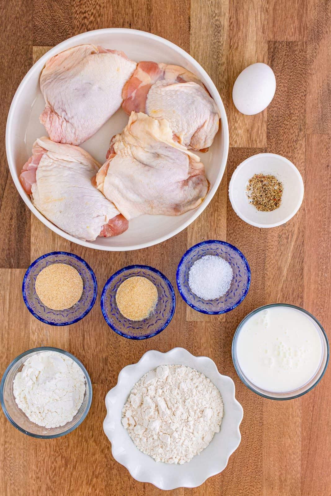 Ingredients needed: buttermilk, egg, all-purpose flour, cornstarch, garlic powder, onion powder, kosher salt, black pepper, bone-in chicken thighs and olive oil spray.