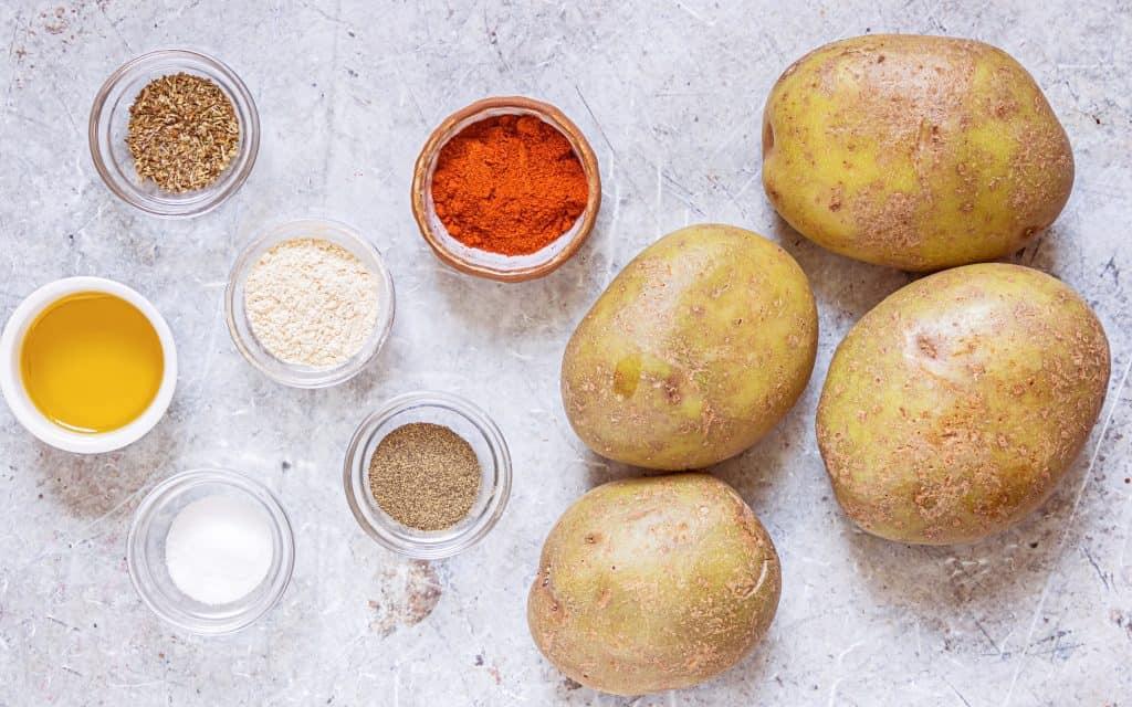 Ingredients needed: russet potatoes, olive oil, garlic powder, smoked paprika, oregano, salt and black pepper.