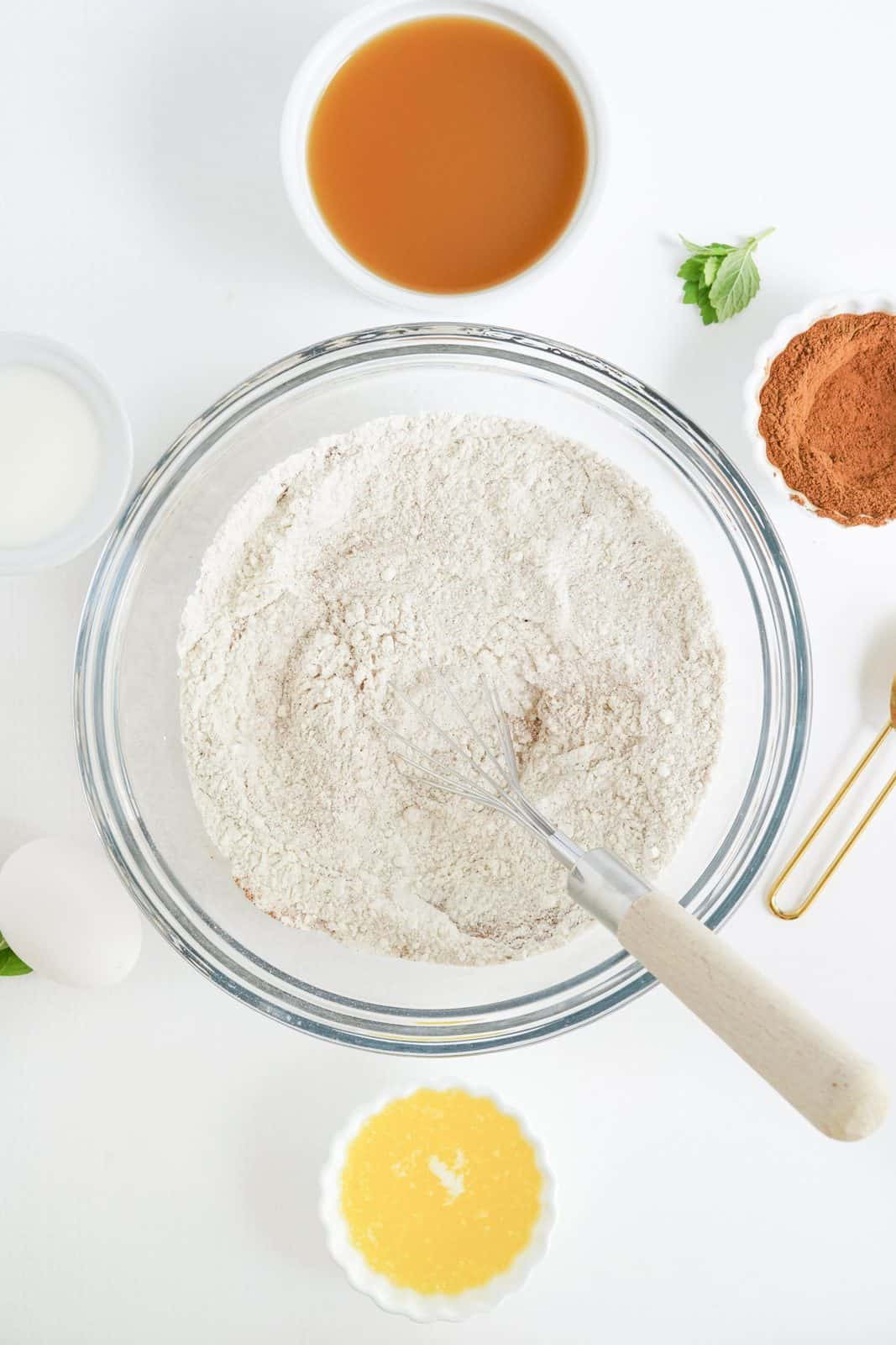 Dry ingredients whisked up in clear bowl.