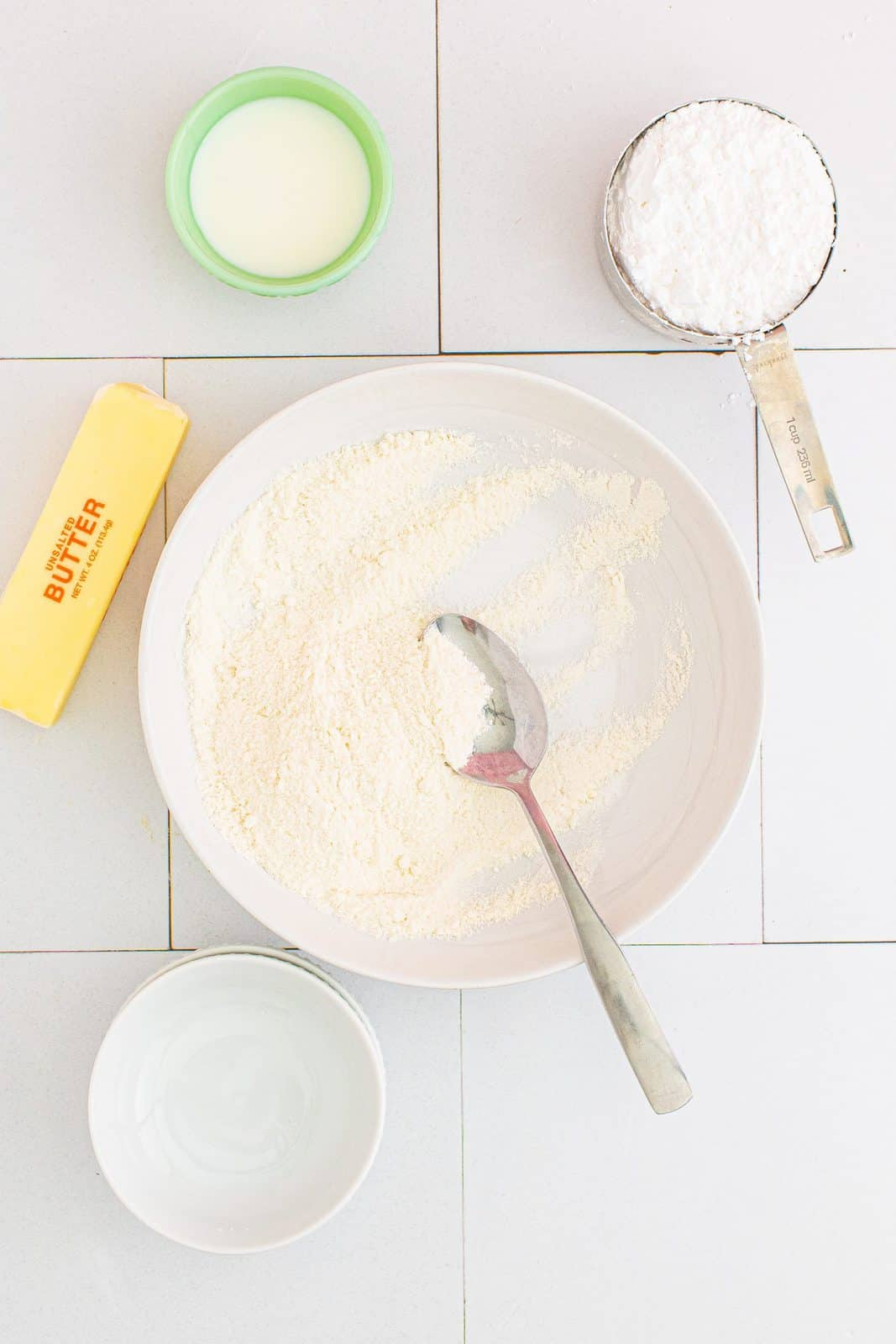 Sugar and flour mixed together in bowl.