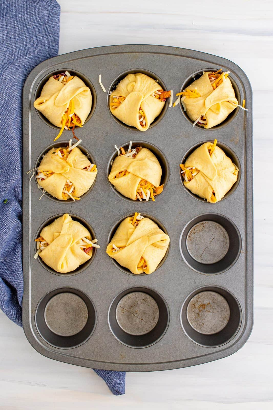 Cups folded and sealed in muffin tin.