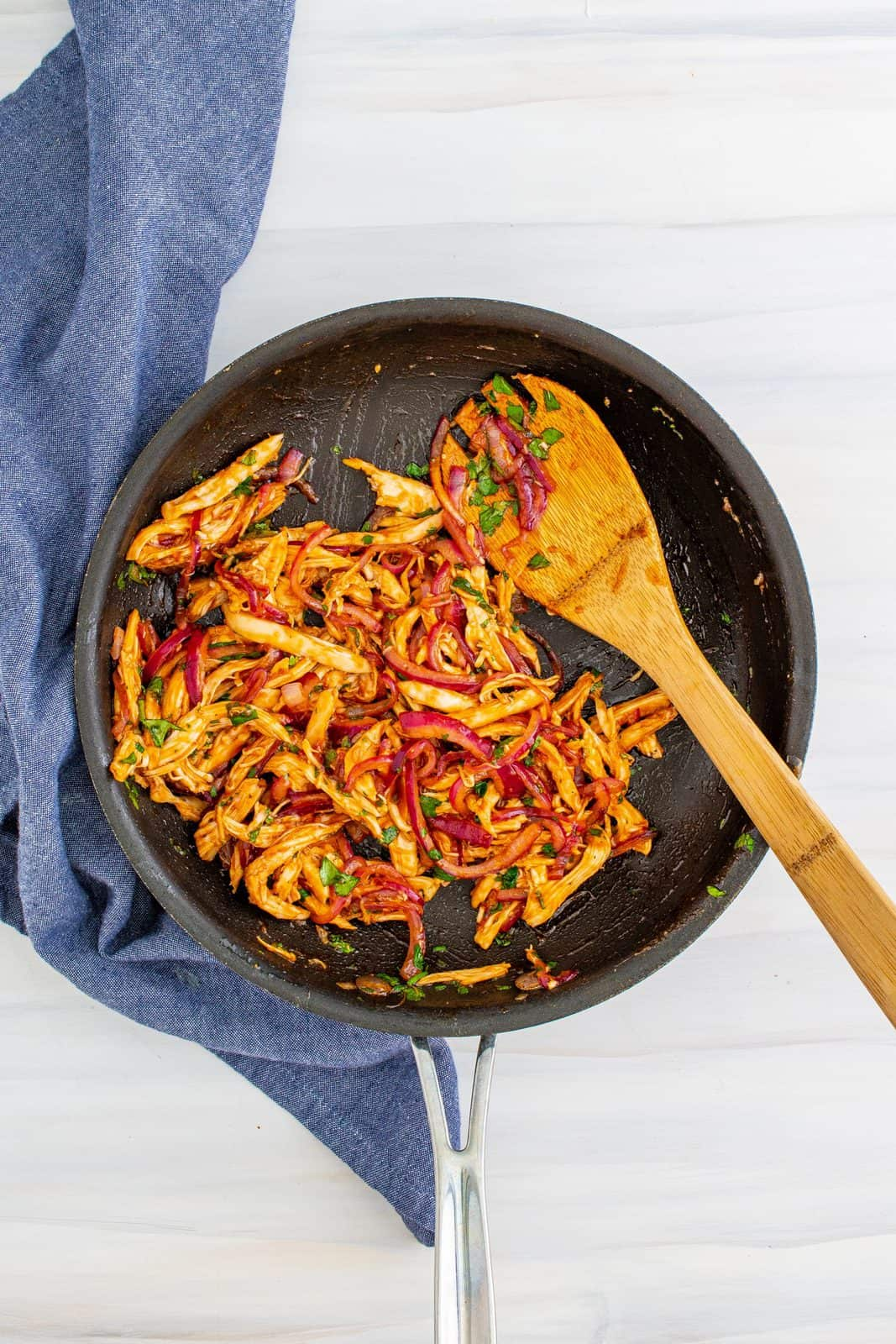 Chicken and bbq mix all stirred together in a skillet.