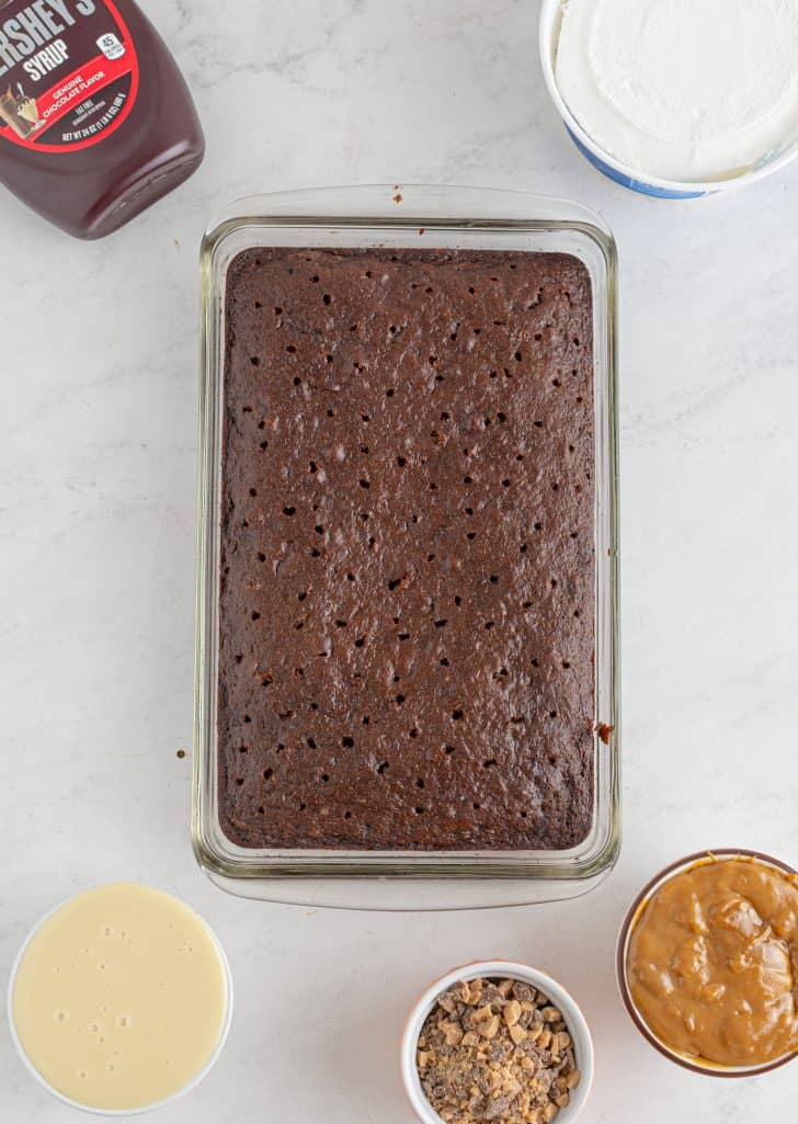 Holes poked in cake.
