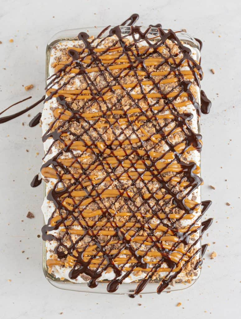 Chocolate syrup drizzled over cake.