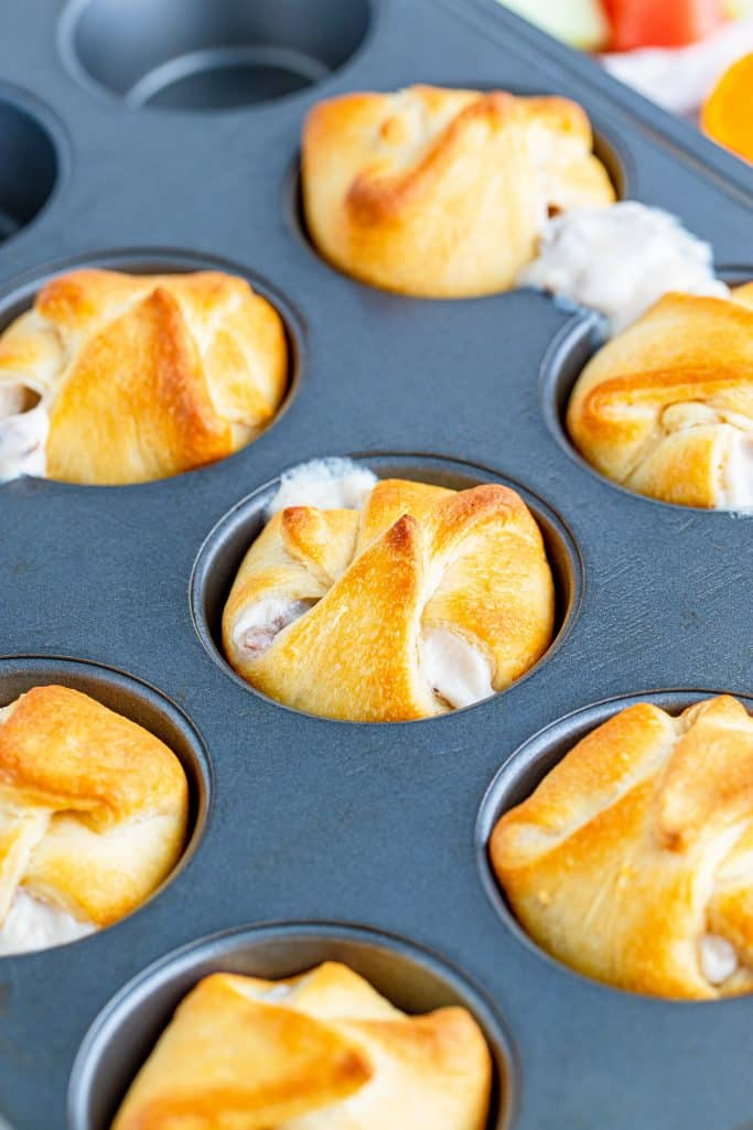 Finished Biscuit and Gravy Cups baked and golden in muffin pan.