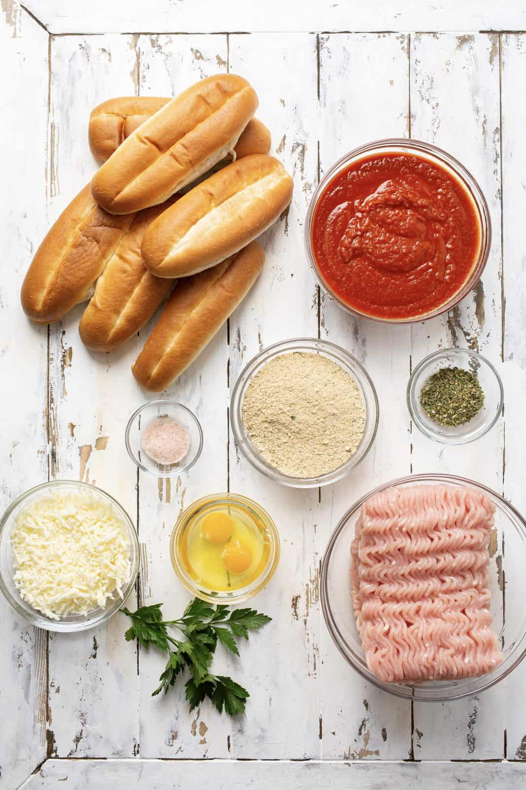 Ingredients needed: lean ground turkey, Italian bread crumbs eggs, italian seasoning, salt, marinara or pasta sauce, sub rolls, mozzarella cheese and fresh parsley.