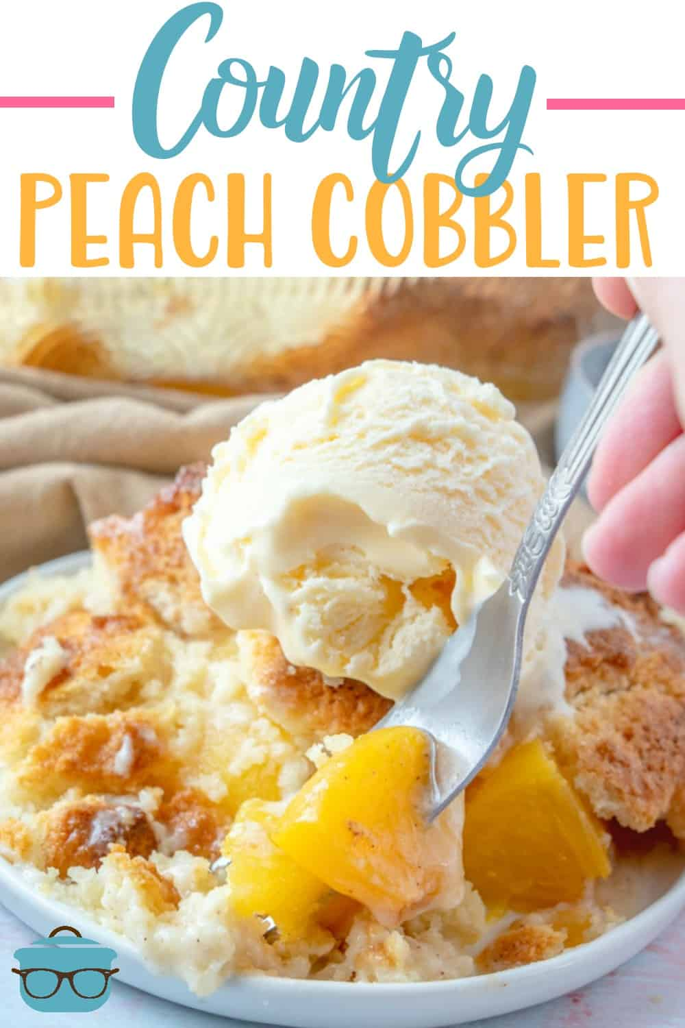 serving of peach cobbler being scooped up with a fork.