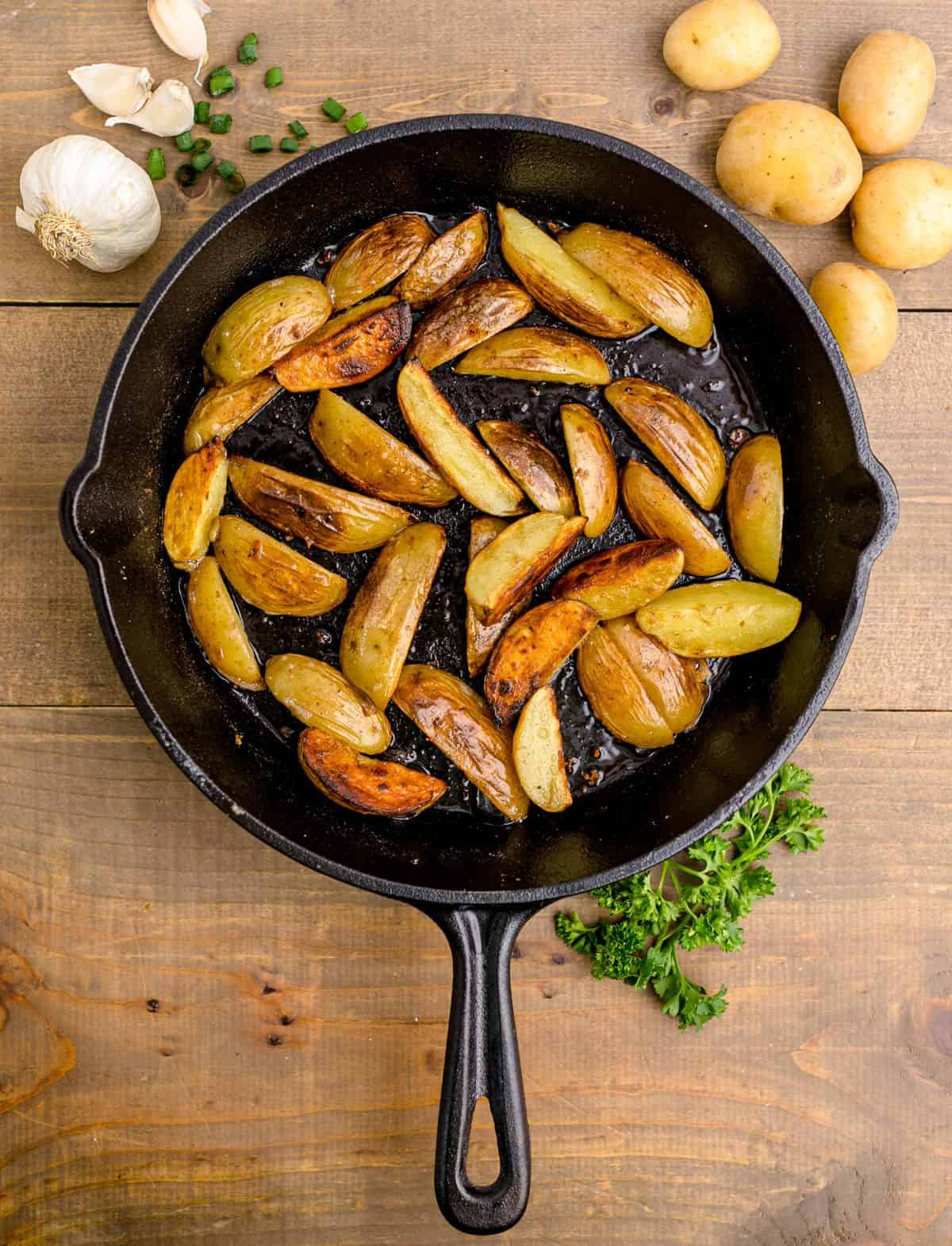Browned potatoes in cast iron skillet.