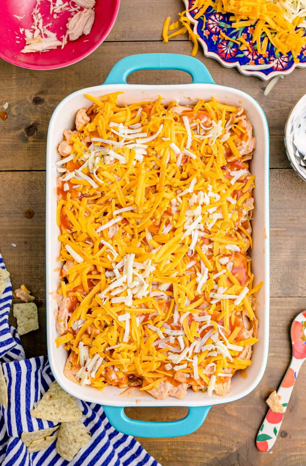 Enchilada mixture topped with shredded cheese.