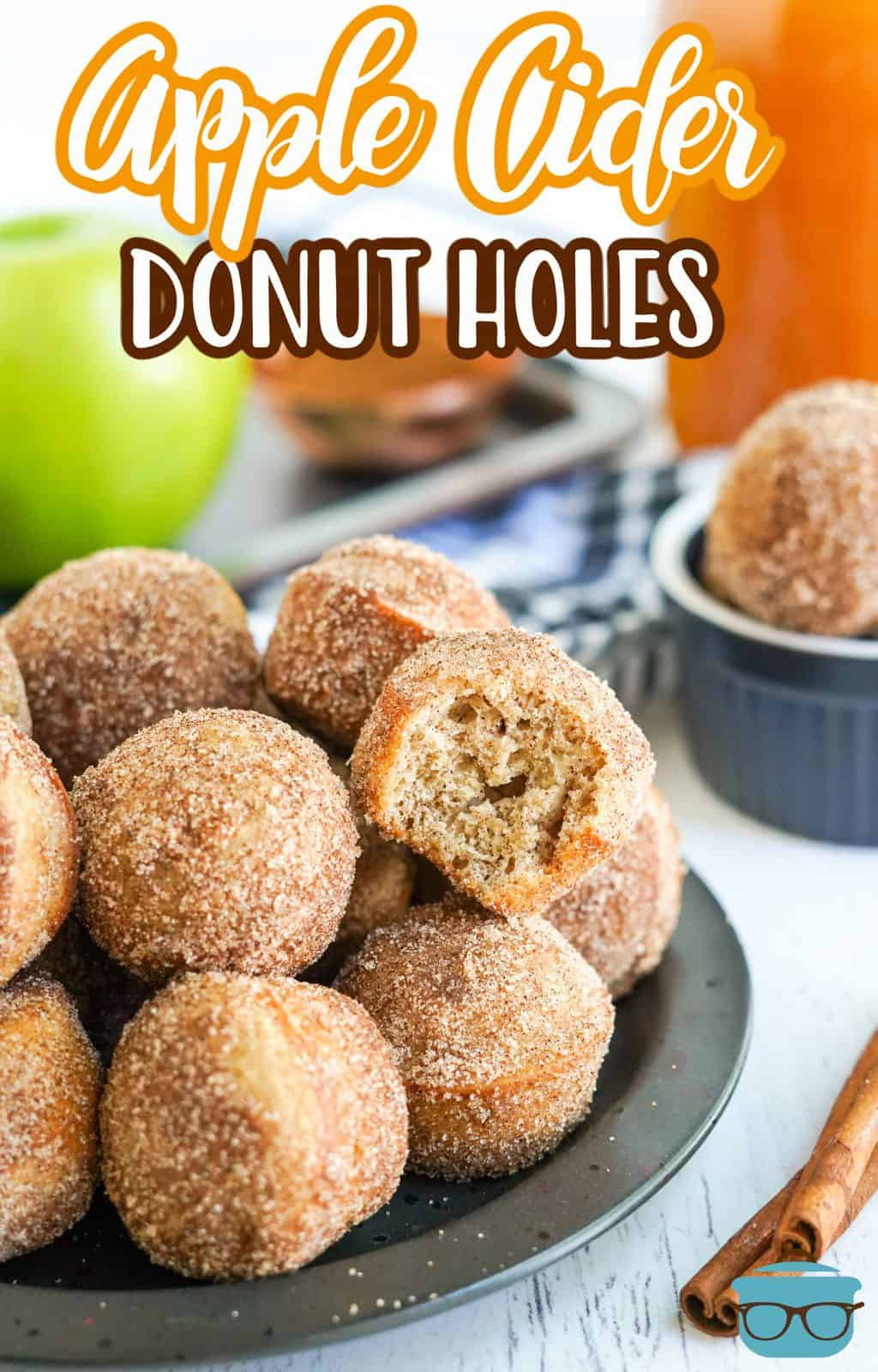Stacked Apple Cider Donut Holes Pinterest image with bite taken out of one.