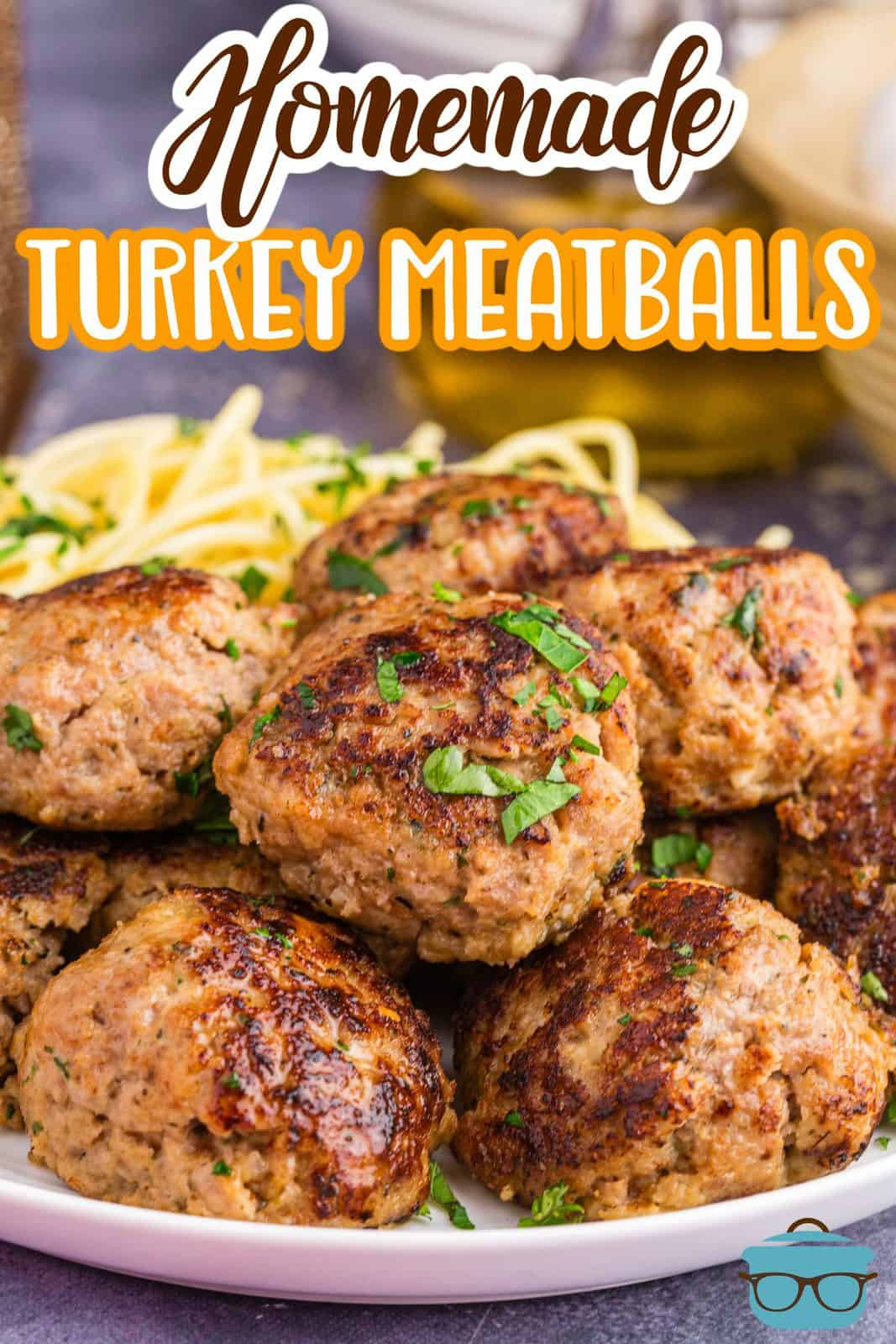 Pinterest image of plated Homemade Turkey Meatballs garnished with parsley.