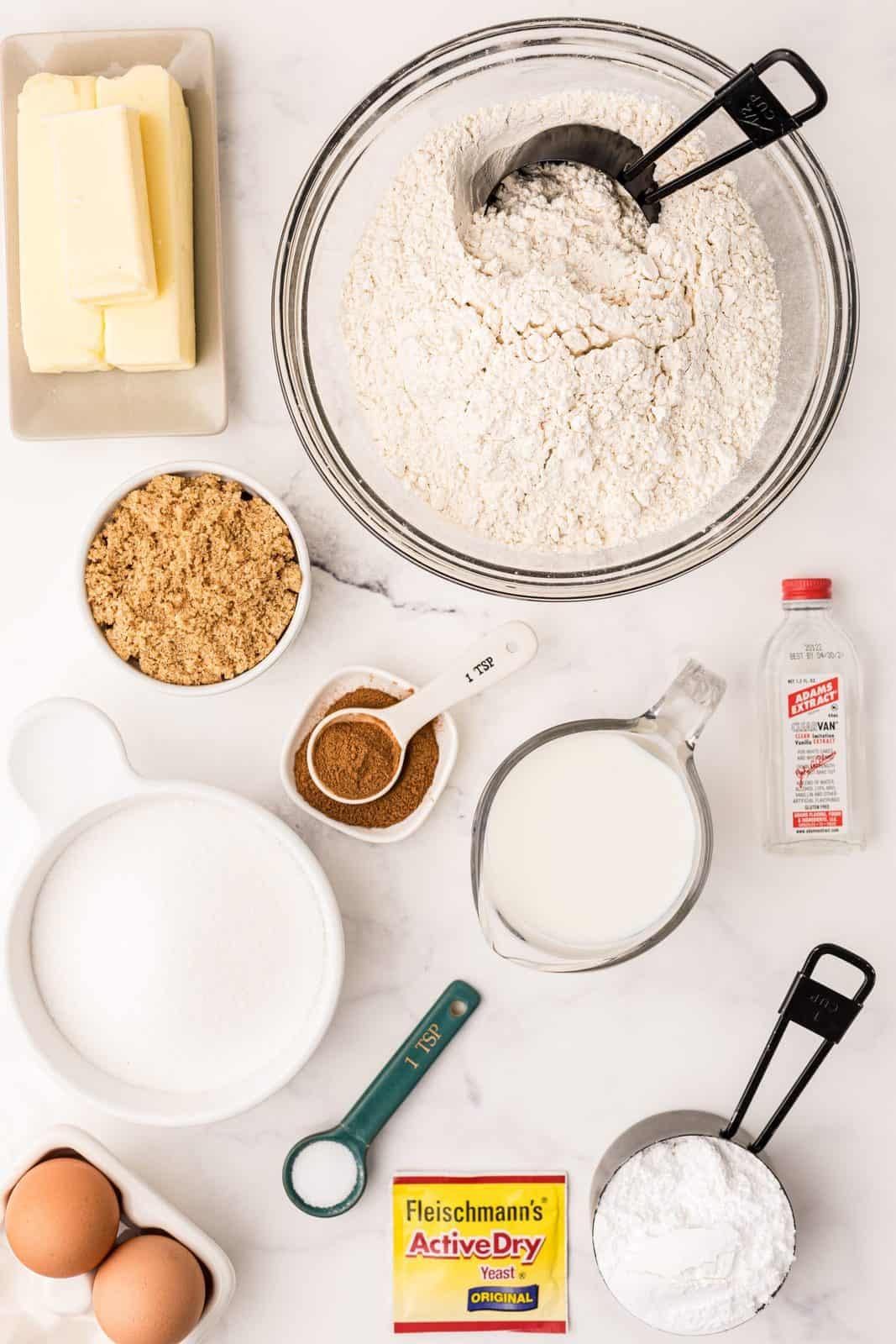 Ingredients needed: whole milk, active dry yeast, granulated sugar, eggs, butter, salt, bread flour, cinnamon, brown sugar, vanilla and powdered sugar.