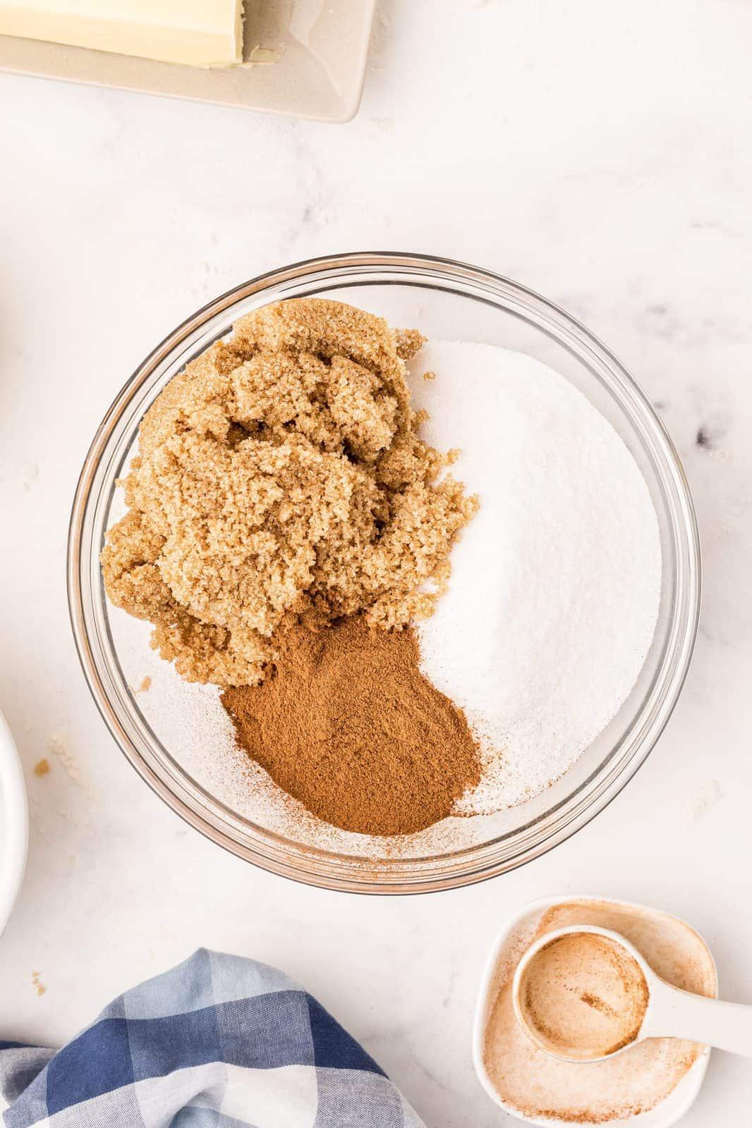 Granulated sugar, brown sugar and cinnamon in bowl.