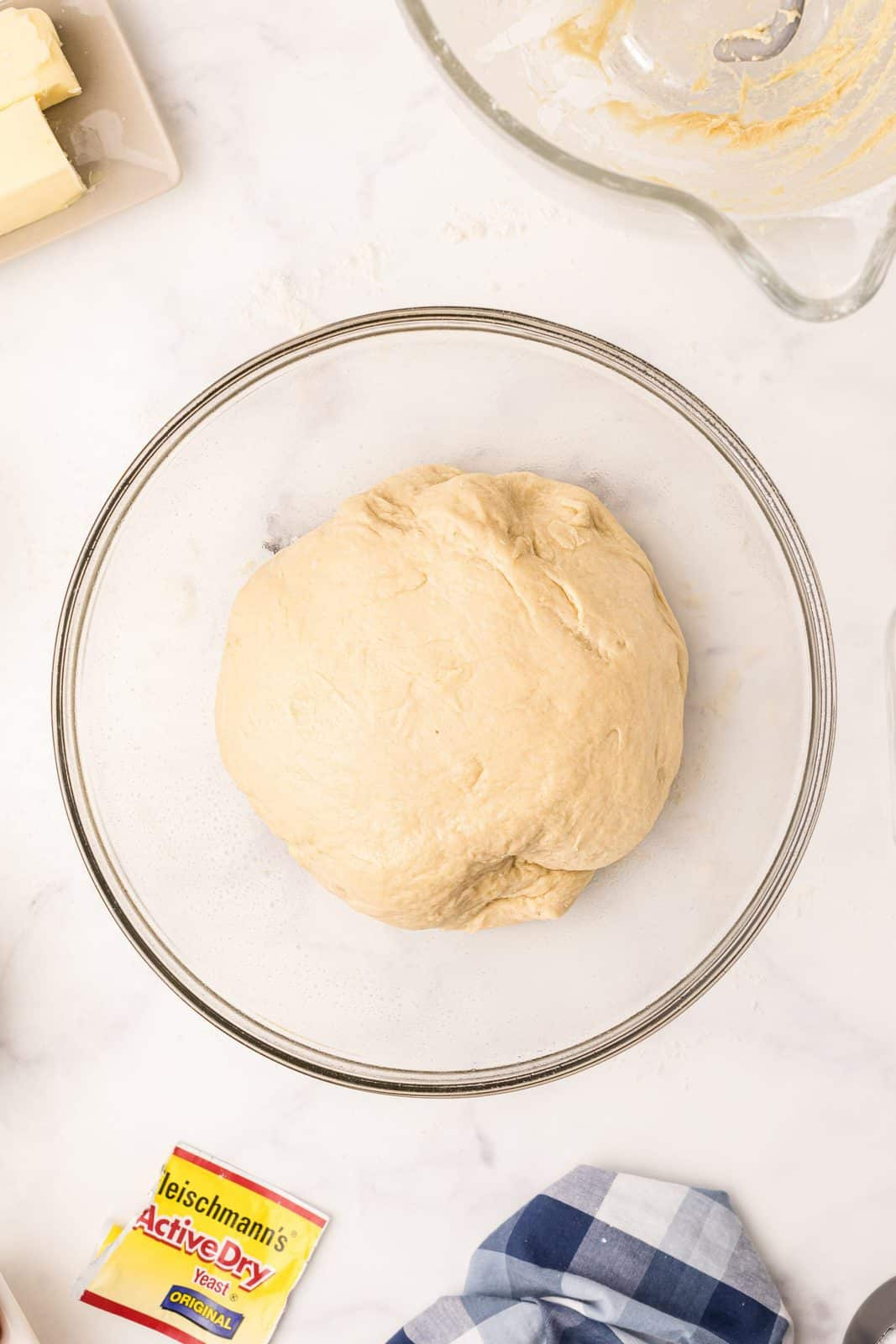 Dough added to greased bowl before letting rise.