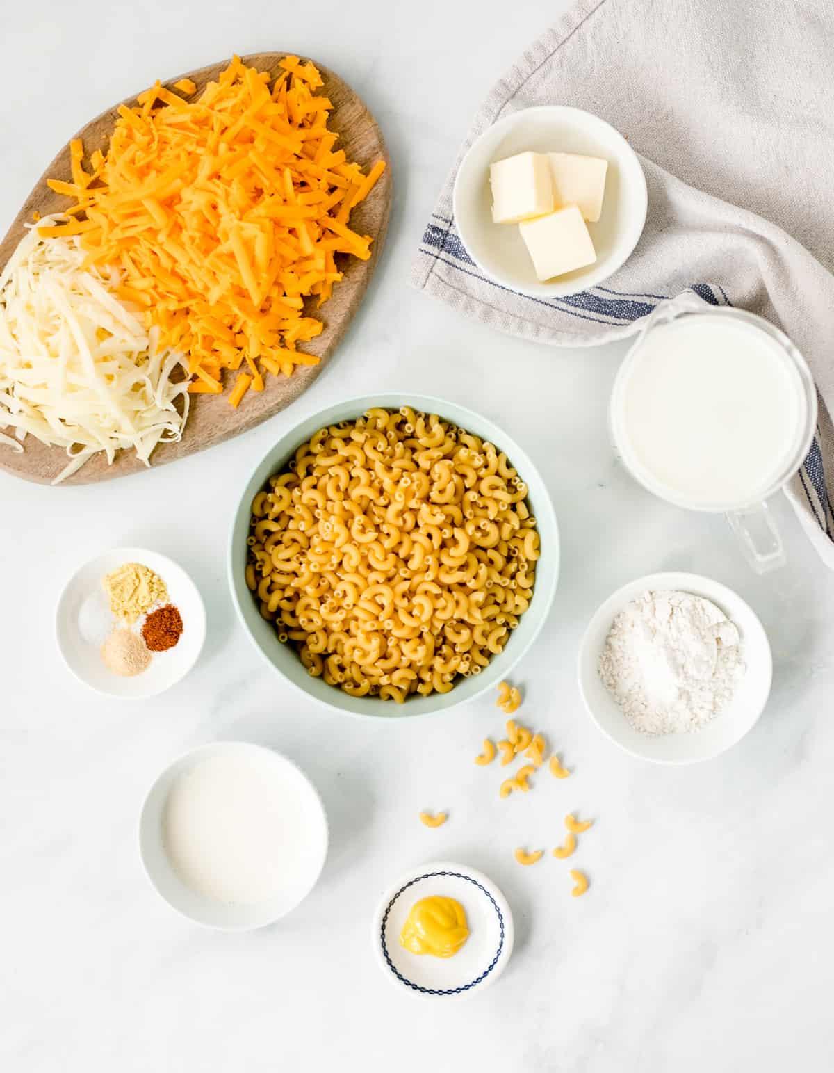 Ingredients needed: elbow noodles, pasta water, unsalted butter, all-purpose flour, mustard, whole milk, heavy cream, ground mustard, salt, garlic powder, cayenne pepper, sharp cheddar cheese and mozzarella cheese.