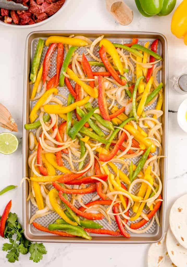 Vegetables spread out over sheet pan.