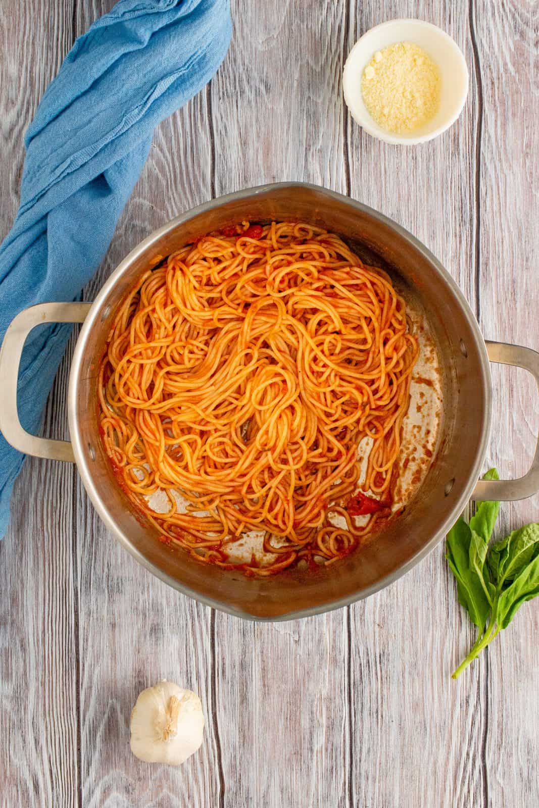 Spaghetti and sauce mixed together in pot.