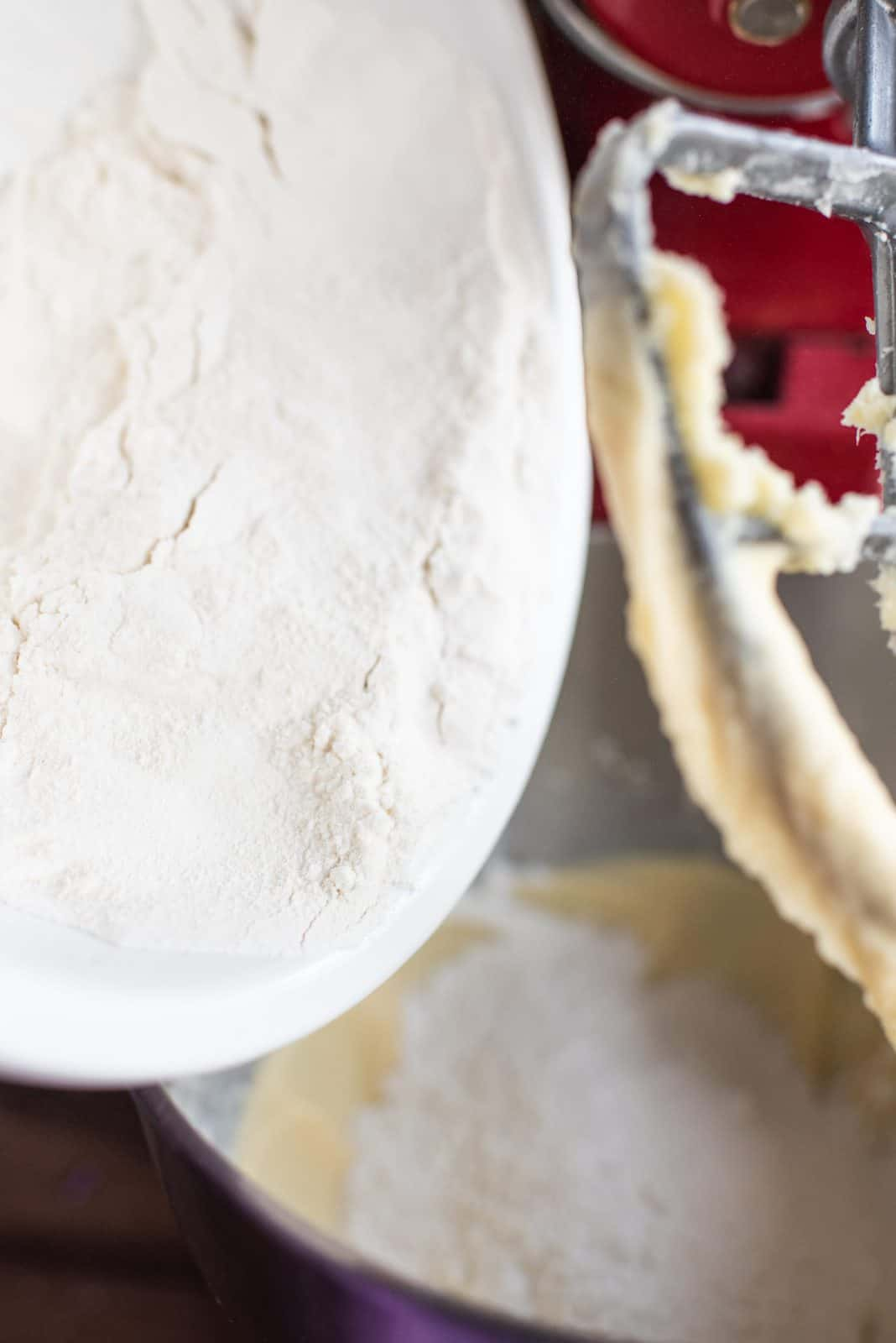 Flour slowly being added to wet mixture.